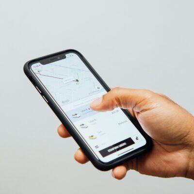 Man holding a phone looking at social media